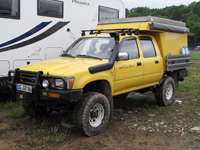 abenteuer-allrad-2013-base-camp-22-toyota-hilux-camper-thumb.jpg